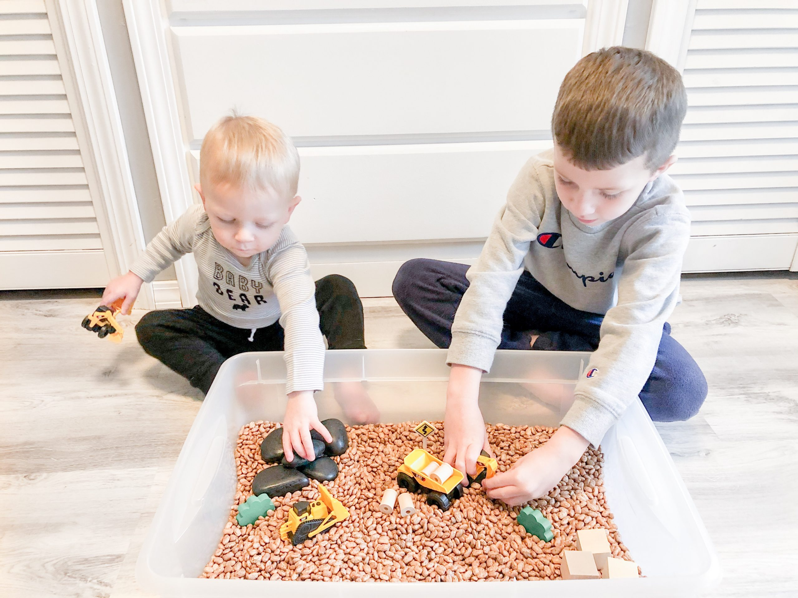 Sensory bin idea and instructions.  The construction zone theme is wonderful for all ages.